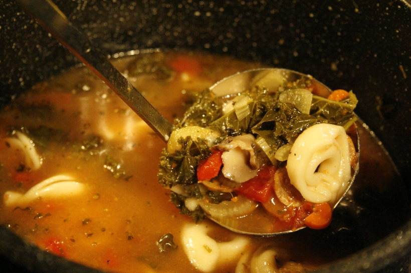 One of my masterpieces that I make every year (and disappears as quickly as it's made!) - tortellini, kale, tomato, mushrooms, spices, and hot Italian sausage in homemade veggie stock.